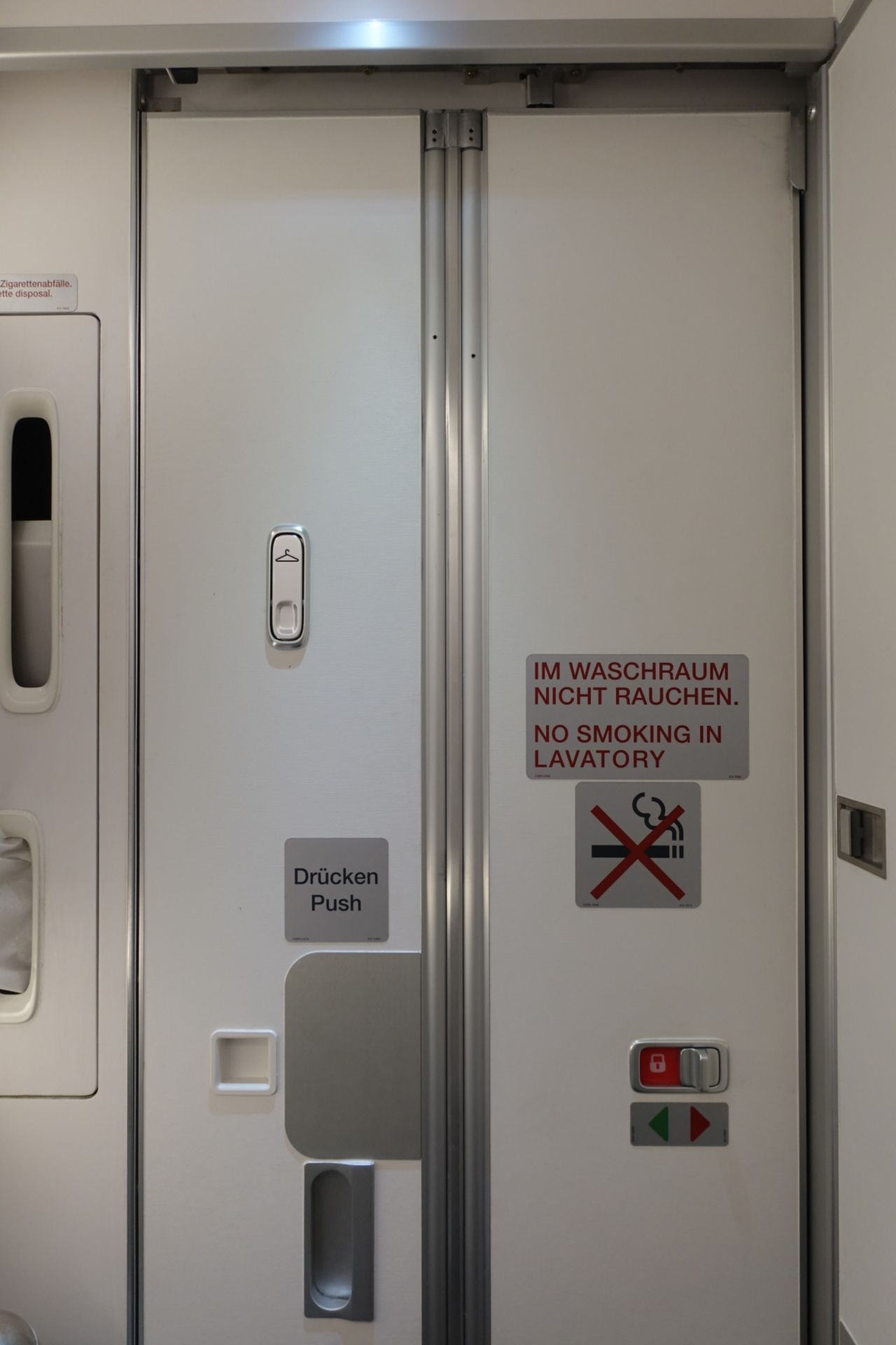 There Are Two Lavatories At The Back Of The Plane. I Took The One In & Airplane Bathroom Door - [aragundem.com]